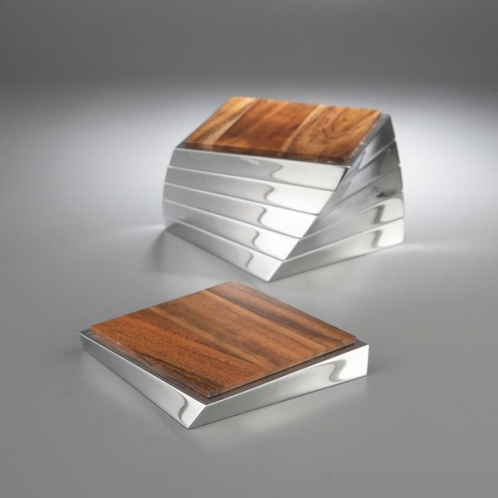 Twist Coaster Set The set of 6 richly grained acacia wood squares are set on gleaming Nambé Alloy bases to protect tabletops from drips and water rings. while offering dapper elegance at the same time.